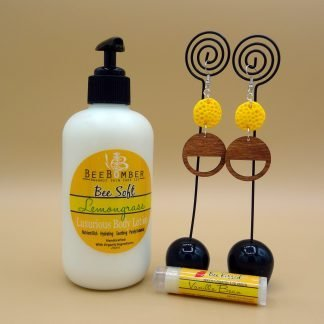 Bee Soft Lemongrass Lotion. One pair of yellow and wood earrings. Vanilla lip balm. Gift box