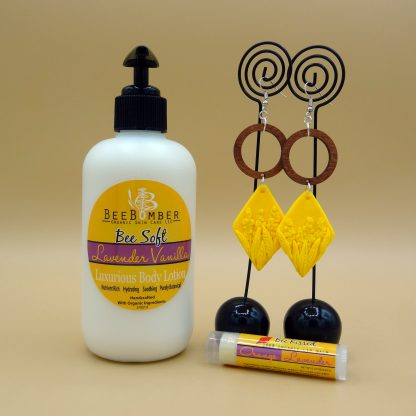 lavender vanilla hand and body lotion, orange lavender lip balm, yellow floral and wooden drop earrings